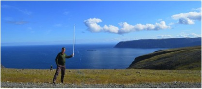 Dave Lowry collecting a sample at Nordkapp. (Photo credit: Nathalie Grassineau.)
